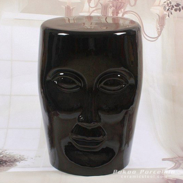 Human face black solid color ceramic stool