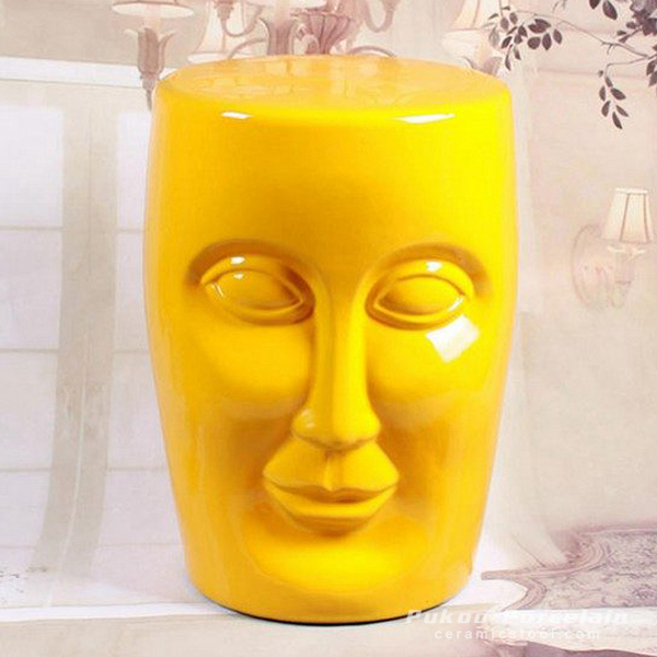 Human face yellow solid color ceramic stool