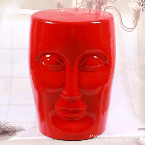 Human face red solid color ceramic stool