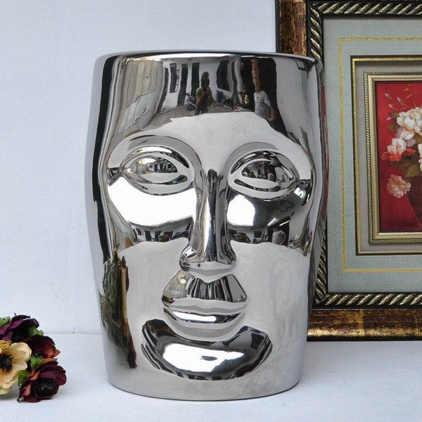 Human face silver solid color ceramic stool