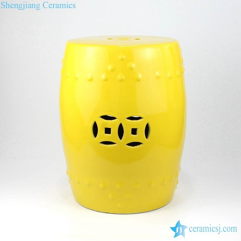 bright yellow stool with hollow decoration
