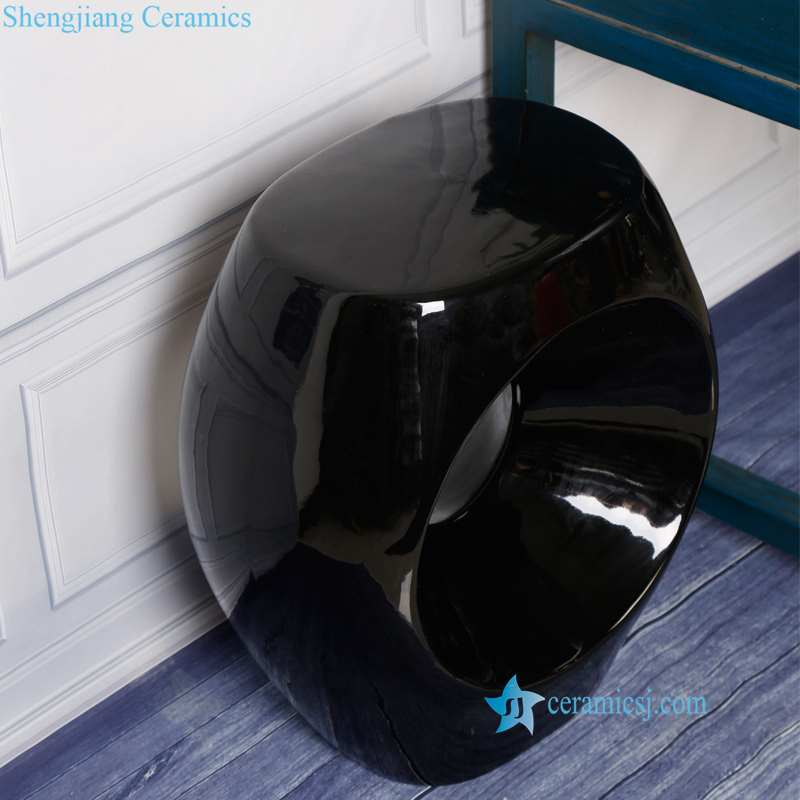 solid black color ceramic stool with hole from overlooking the angle